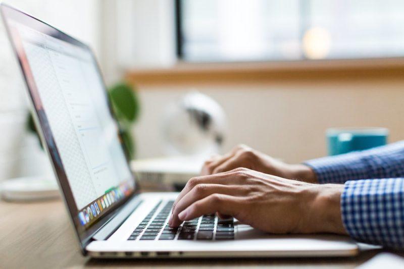 hands-typing-client-centric-brokerage