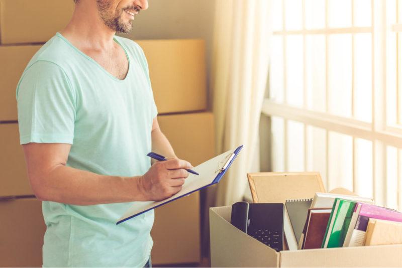 Man making list - last-minute moving tips
