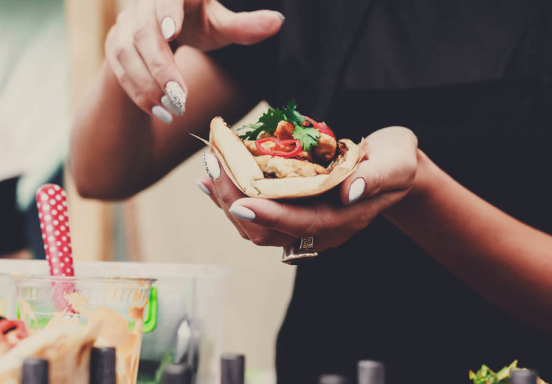 person eating taco - resident event ideas