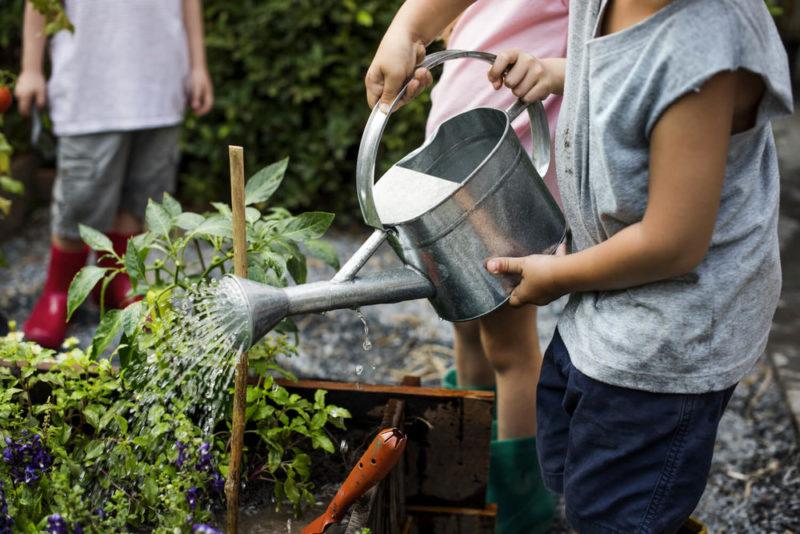 kids watering garden - resident event ideas