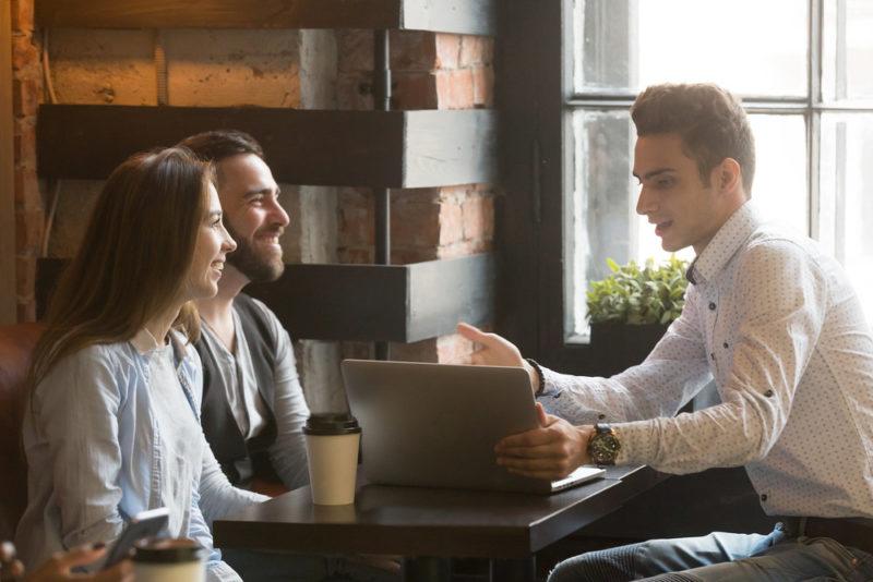 real-estate-agent-talking-to-millennial-couple_millennial-homeownership.jpg