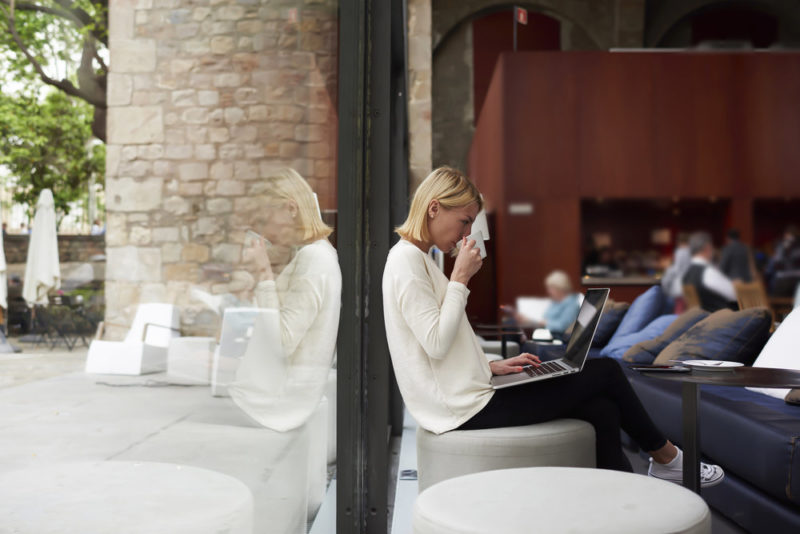 woman-cafe_how-to-save-on-cable-internet-and-phone.jpg