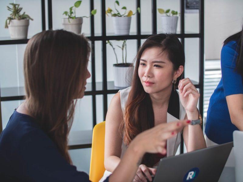 women-speaking-client-centric-brokerage