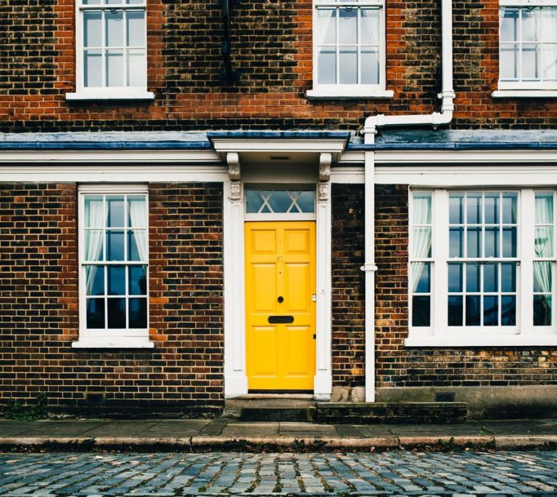 yellow-door-on-brick-home_millennial-homeownership